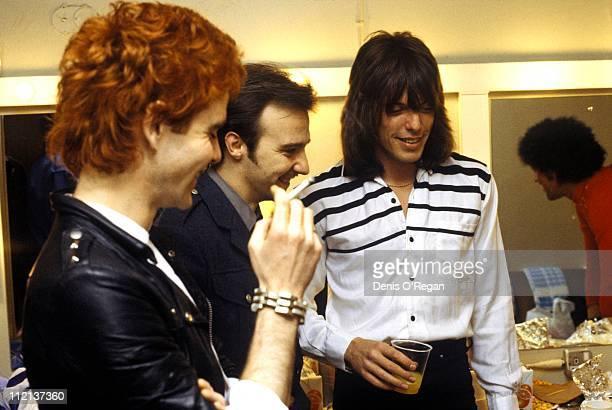 Scott Gorham and Brian Robertson of Thin Lizzy backstage with Midge Ure circa 1980