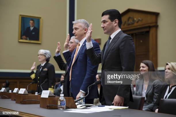 Scott Gottlieb commissioner of the Food and Drug Administration right is sworn in before a House Oversight and Investigations Subcommittee hearing in...