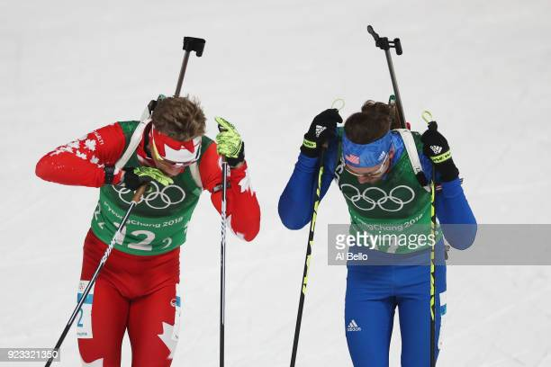 Scott Gow of Canada and Sean Doherty of the United States compete during the Men's 4x75km Biathlon Relay on day 14 of the PyeongChang 2018 Winter...