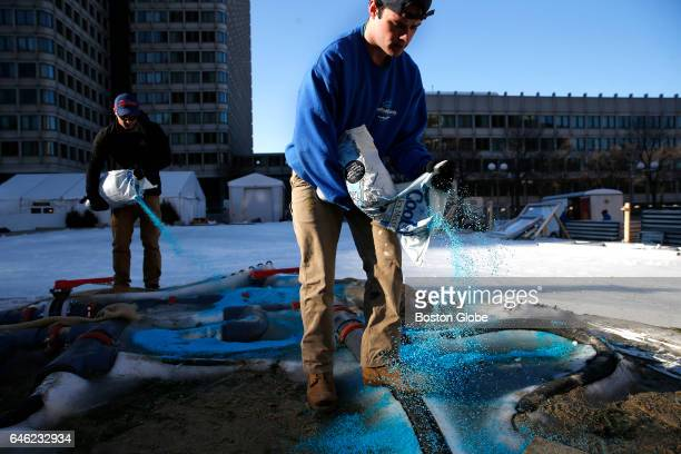 Scott Grealish of Wrentham right and Ben Wyman of Attleboro spread salt on the pipes that were used to create the ice rink at City Hall Plaza in...