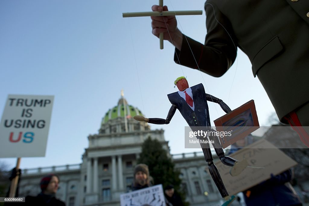 Scott Greges, 35, dressed as Joseph Stalin, holds a marionette puppet of Donald Trump, joining protestors demonstrating outside the Pennsylvania Capitol Building before electors arrive to cast their votes from the election at December 19, 2016 in Harrisburg, Pennsylvania. Electors from all 50 states cast votes today in their respective state capitols. Donald J. Trump won Pennsylvania by less than 1%, the first Republican to carry the state since George H. W. Bush 1992.