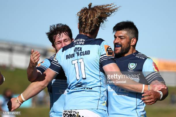 Scott Gregory of Northland scores a try celebrated by Matt Matich of Northland and Jordan Olsen of Northland during the round 4 Mitre 10 Cup match...