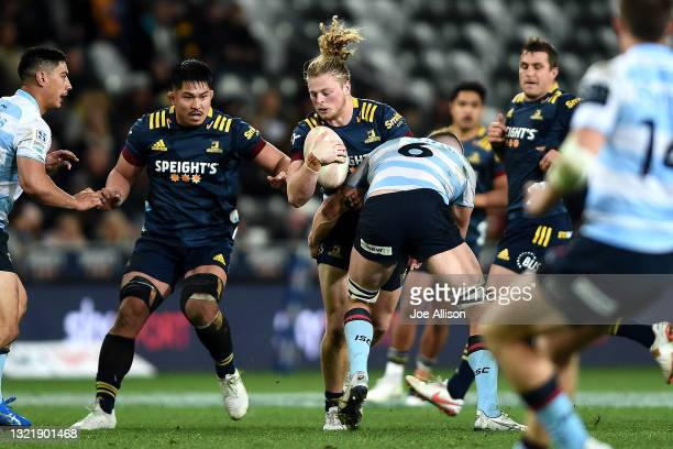 Scott Gregory of the Highlanders runs into the defence during the round four Super Rugby Trans-Tasman match between the Highlanders and the NSW...