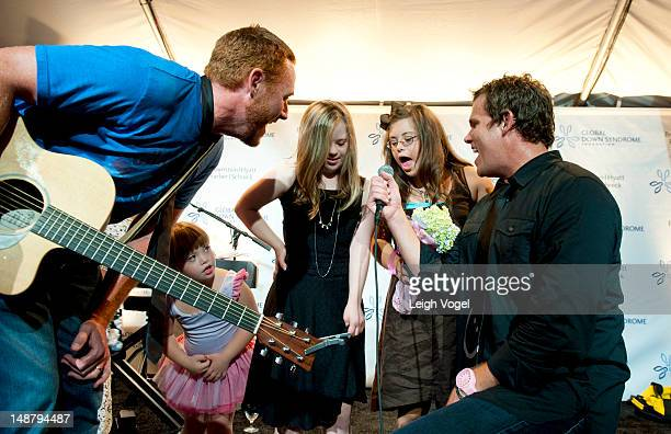 Scott Grimes and Bob Guiney perform during the Global Down Syndrome Foundation 2012 fashion show at Sewall-Belmont House on July 19, 2012 in...