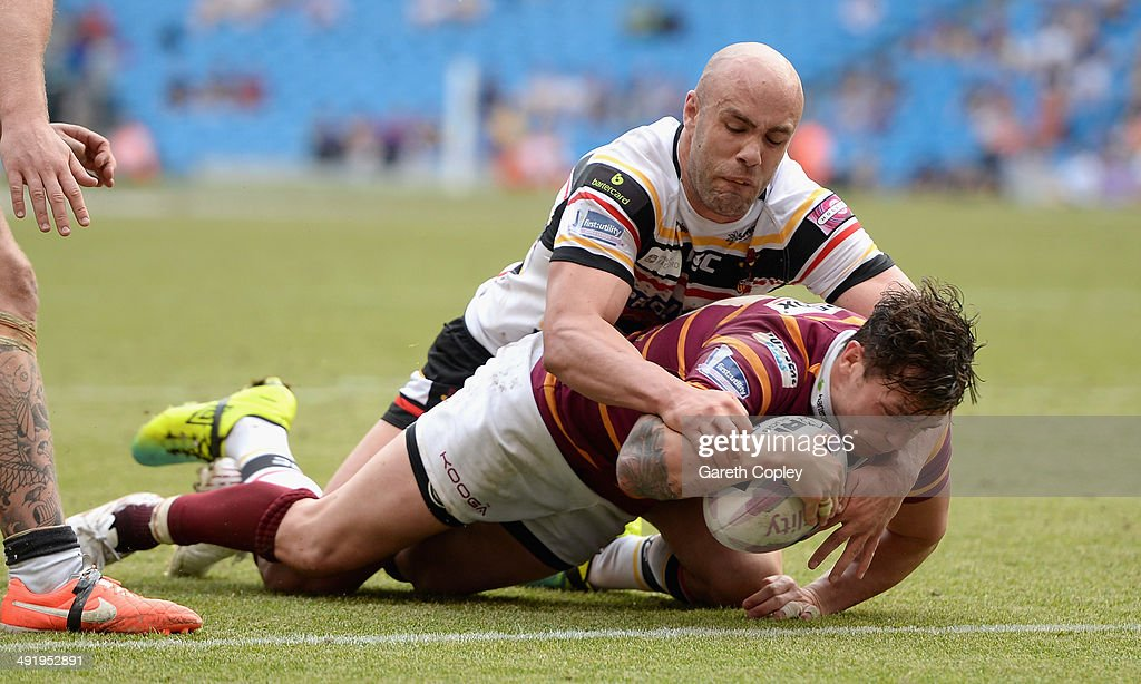 Scott Grix of Huddersfield Giants scores a second half try past Adrian Purtell of Bradford Bulls during the Super League match between Huddersfield Giants and Bradford Bulls at Etihad Stadium on May 18, 2014 in Manchester, England.
