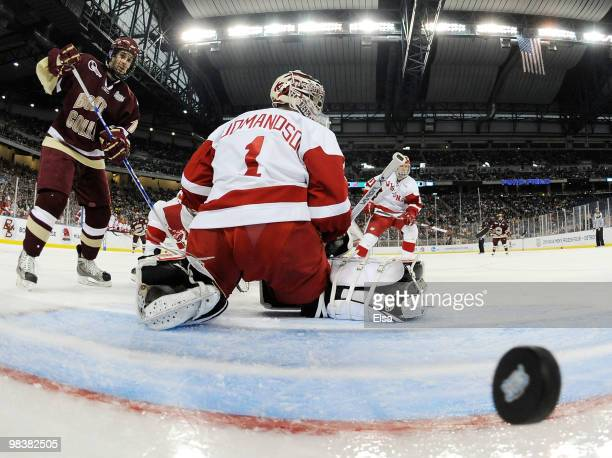 Scott Gudmanson of the Wisconsin Badgers is unable to stop a shot by Ben Smith of the Boston College Eagles on April 10, 2010 during the championship...