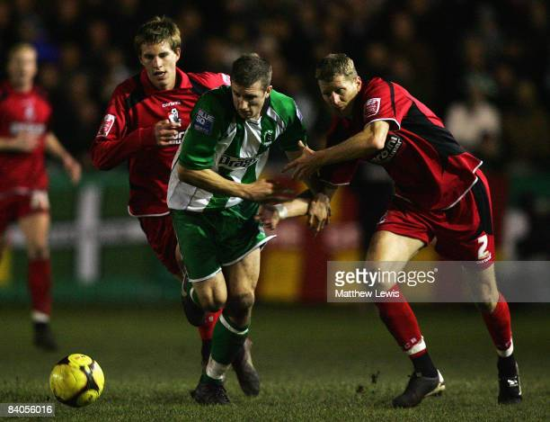 Scott Guyett of Bournemouth holds onto Anthony Hume of Blyth during the FA Cup 2nd Round Replay match between Blyth Spartans and AFC Bournemouth at...