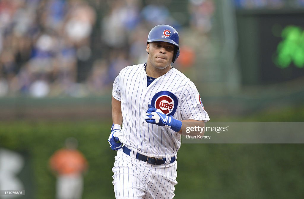Scott Hairston #21 of the Chicago Cubs rounds the bases after hitting a solo home run during the sixth inning against the Houston Astros at Wrigley Field on June 21, 2013 in Chicago, Illinois.