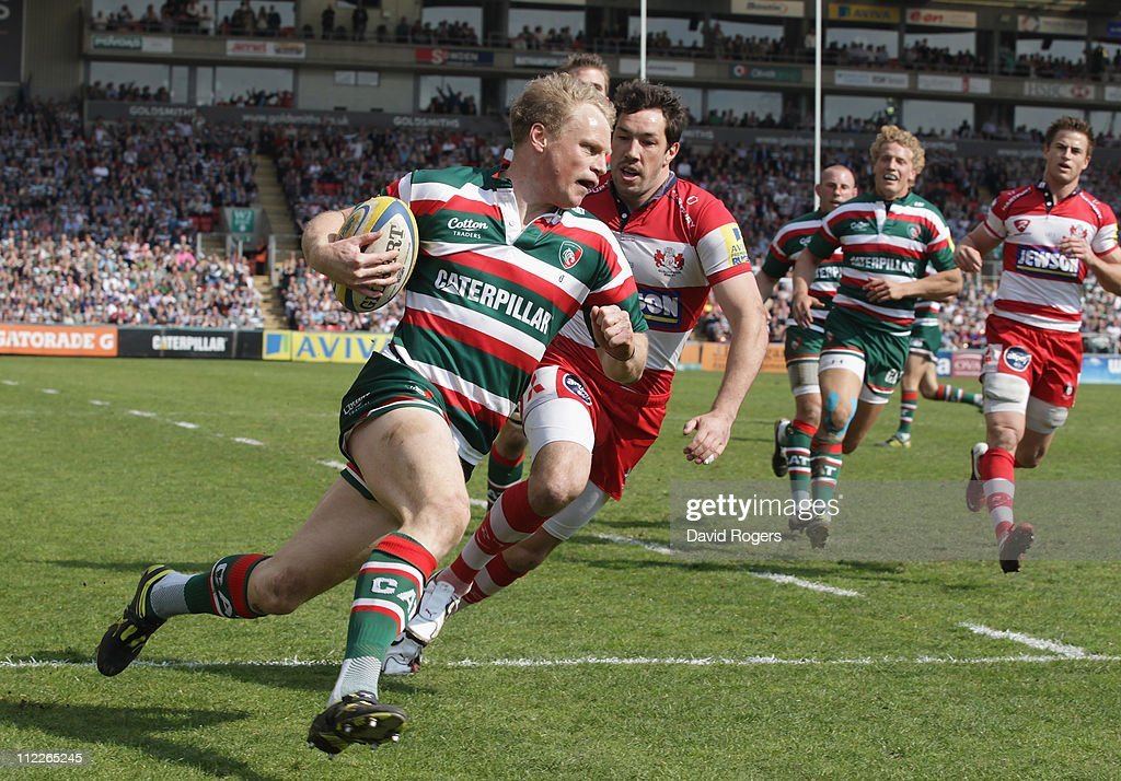 Scott Hamilton of Leicester races cleasr of Tom Voyce to score a try during the Aviva Premiership match between Leicester Tigers and Gloucester at Welford Road on April 16, 2011 in Leicester, England.