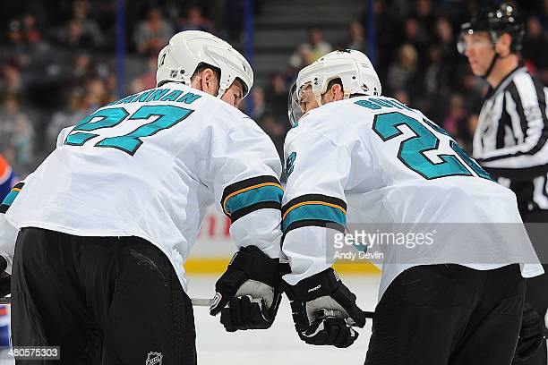 Scott Hannan and Dan Boyle of the San Jose Sharks exchange words in a game against the Edmonton Oilers on March 25 2014 at Rexall Place in Edmonton...