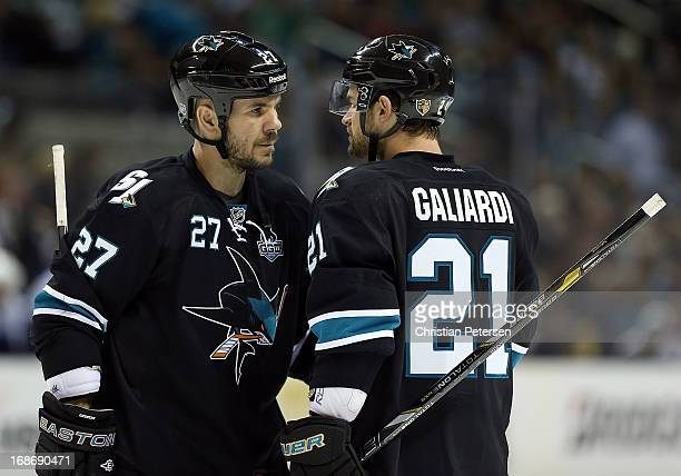 Scott Hannan and TJ Galiardi of the San Jose Sharks in Game Four of the Western Conference Quarterfinals against the Vancouver Canucks during the...