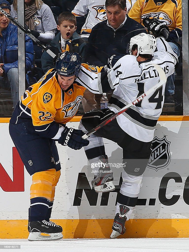 Scott Hannan #22 of the Nashville Predators checks Justin Williams #14 of the Los Angeles Kings during an NHL game at the Bridgestone Arena on February 7, 2013 in Nashville, Tennessee.