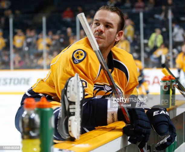 Scott Hannan of the Nashville Predators stretches during warmups against the St Louis Blues during an NHL game at the Bridgestone Arena on January 21...