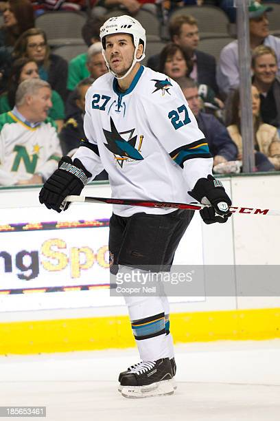 Scott Hannan of the San Jose Sharks looks on during the game against the Dallas Stars on October 17 2013 at the American Airlines Center in Dallas...