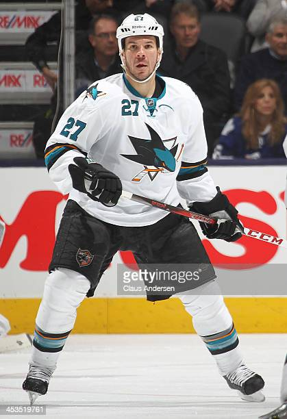 Scott Hannan of the San Jose Sharks skates against the Toronto Maple Leafs during an NHL game at the Air Canada Centre on December 3 2013 in Toronto...