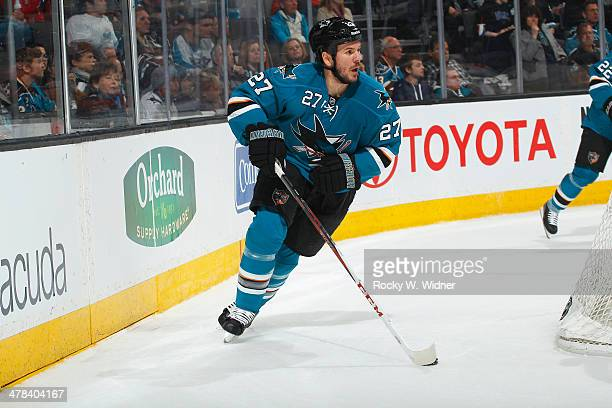 Scott Hannan of the San Jose Sharks skates with control of the puck against the Carolina Hurricanes at SAP Center on March 4 2014 in San Jose...