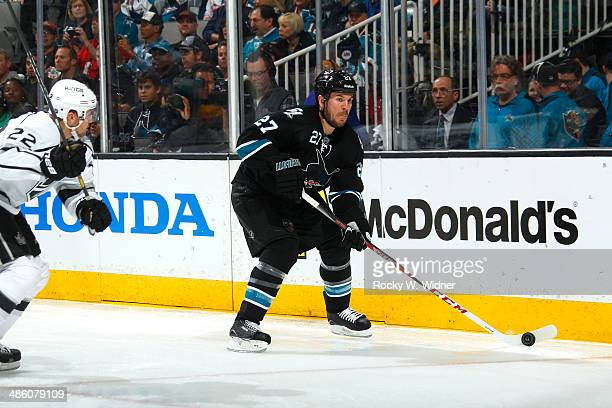 Scott Hannan of the San Jose Sharks skates with the puck against the Los Angeles Kings in Game Two of the First Round of the 2014 NHL Stanley Cup...