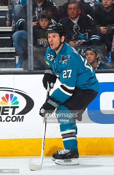 Scott Hannan of the San Jose Sharks skates with the puck against the Colorado Avalanche at SAP Center on April 11 2014 in San Jose California