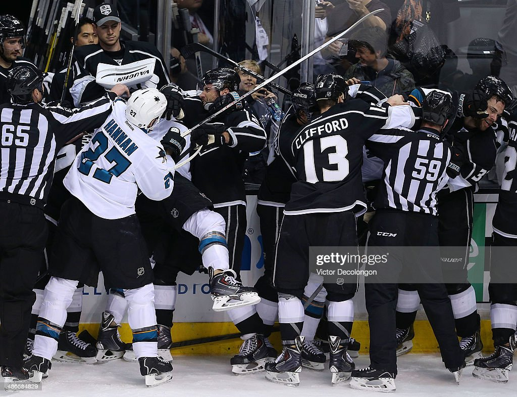 Scott Hannan #27, Raffi Torres #13 and Mike Brown #18 of the San Jose Sharks scrum with Mike Richards #10, Jarret Stoll #28 and Willie Mitchell #33 of the Los Angeles Kings as Kyle Clifford #13 and Justin Williams #14 of the Los Angeles Kings come to the aid of Mitchell near the Kings bench area in the third period during Game Four of the First Round of the 2014 NHL Stanley Cup Playoffs at Staples Center on April 24, 2014 in Los Angeles, California. The Kings defeated the Sharks 6-3.