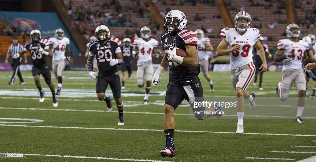 Scott Harding #29 of the Hawaii Warriors carries the ball in for a touchdown against the UNLV Rebels during a NCAA college football game between the UNLV Rebels and the Hawaii Warriors on November 24, 2012 at Aloha Stadium in Honolulu, Hawaii.