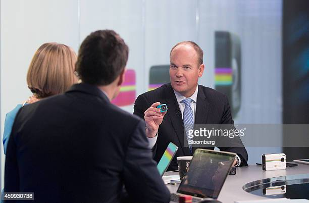 Scott Hardy chief executive officer of Polaroid right holds one of the company's Cube digital cameras during a Bloomberg Television interview in...