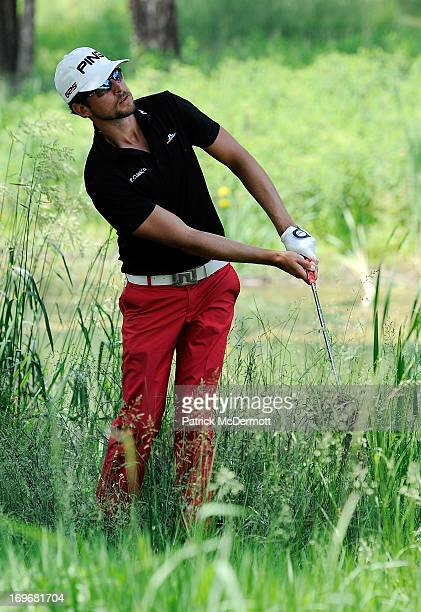Scott Harrington chips out of the rough onto the green on the sixth hole during Round One of the Webcom Tour MidAtlantic Championship on May 30 2013...