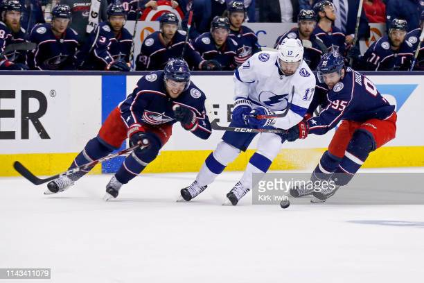 Scott Harrington of the Columbus Blue Jackets and Matt Duchene battle for control of the puck with Alex Killorn of the Tampa Bay Lightning in Game...