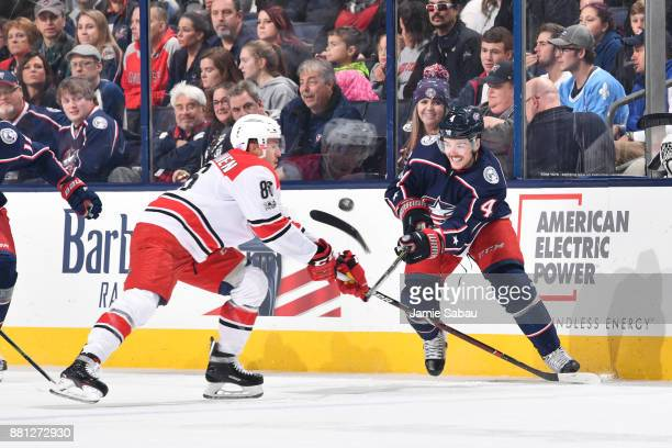 Scott Harrington of the Columbus Blue Jackets breaks his stick while battling for the puck with Teuvo Teravainen of the Carolina Hurricanes during...