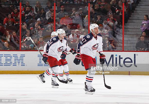 Scott Harrington of the Columbus Blue Jackets celebrates his first career NHL goal with teammates including Dalton Prout during an NHL game against...