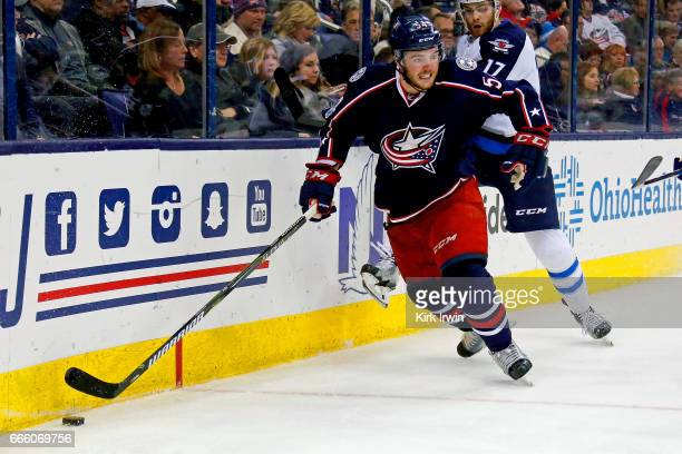Scott Harrington of the Columbus Blue Jackets controls the puck during the game against the Winnipeg Jets on April 6 2017 at Nationwide Arena in...