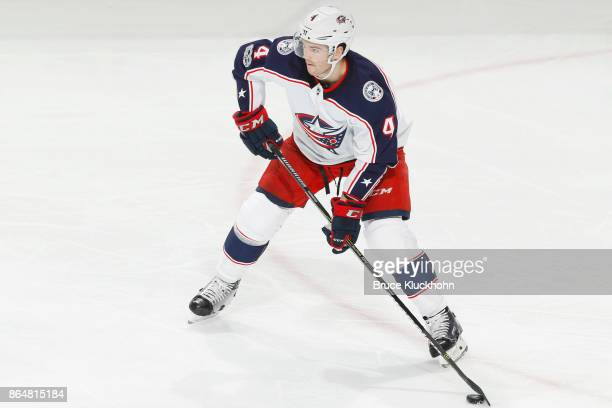 Scott Harrington of the Columbus Blue Jackets handles the puck against the Minnesota Wild during the game at the Xcel Energy Center on October 14...