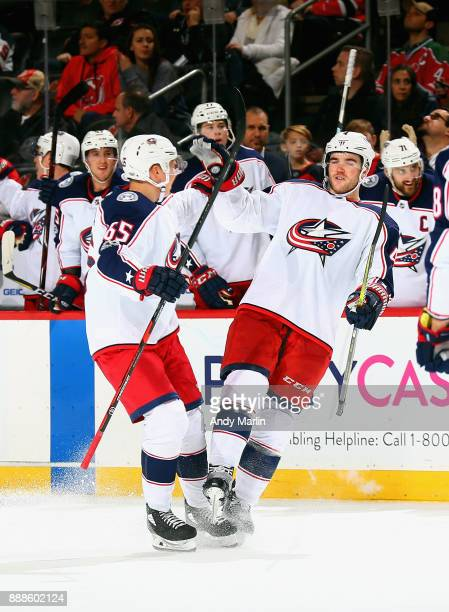 Scott Harrington of the Columbus Blue Jackets is congratulated by Markus Nutivaara after scoring a secondperiod goal against the New Jersey Devils...