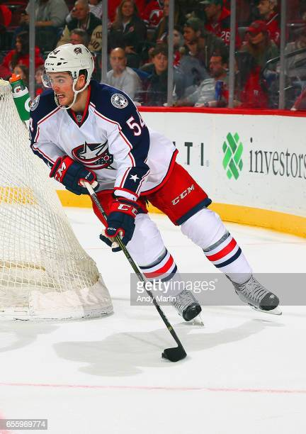 Scott Harrington of the Columbus Blue Jackets plays the puck against the New Jersey Devils during the game at Prudential Center on March 19 2017 in...