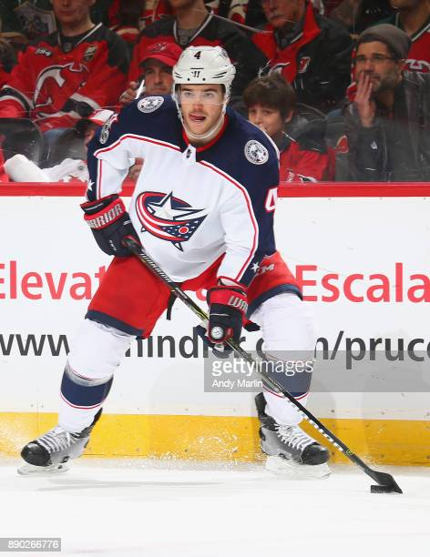 Scott Harrington of the Columbus Blue Jackets plays the puck during the game against the New Jersey Devils at Prudential Center on December 8 2017 in...