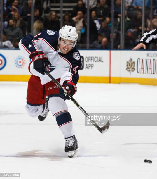 Scott Harrington of the Columbus Blue Jackets shoots against the Toronto Maple Leafs during the first period at the Air Canada Centre on January 8...