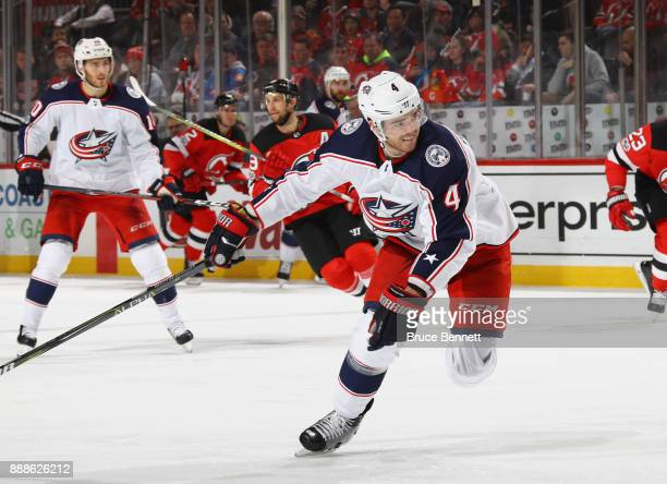 Scott Harrington of the Columbus Blue Jackets skates against the New Jersey Devils at the Prudential Center on December 8 2017 in Newark New Jersey...