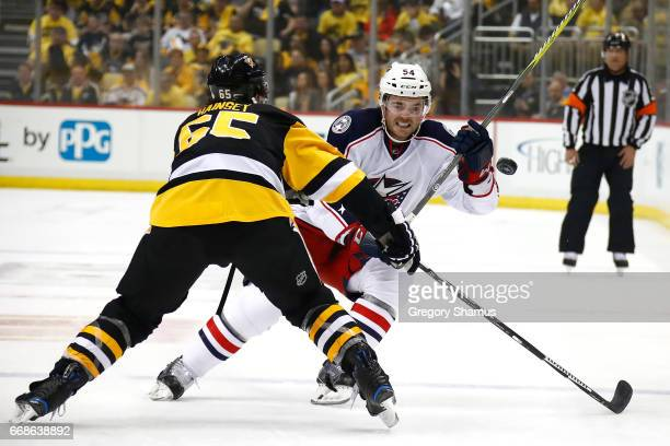 Scott Harrington of the Columbus Blue Jackets tries to get around Ron Hainsey of the Pittsburgh Penguins during the first period in Game Two of the...