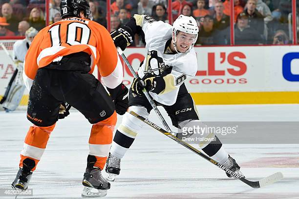 Scott Harrington of the Pittsburgh Penguins passes around Brayden Schenn of the Philadelphia Flyers at the Wells Fargo Center on January 20 2015 in...
