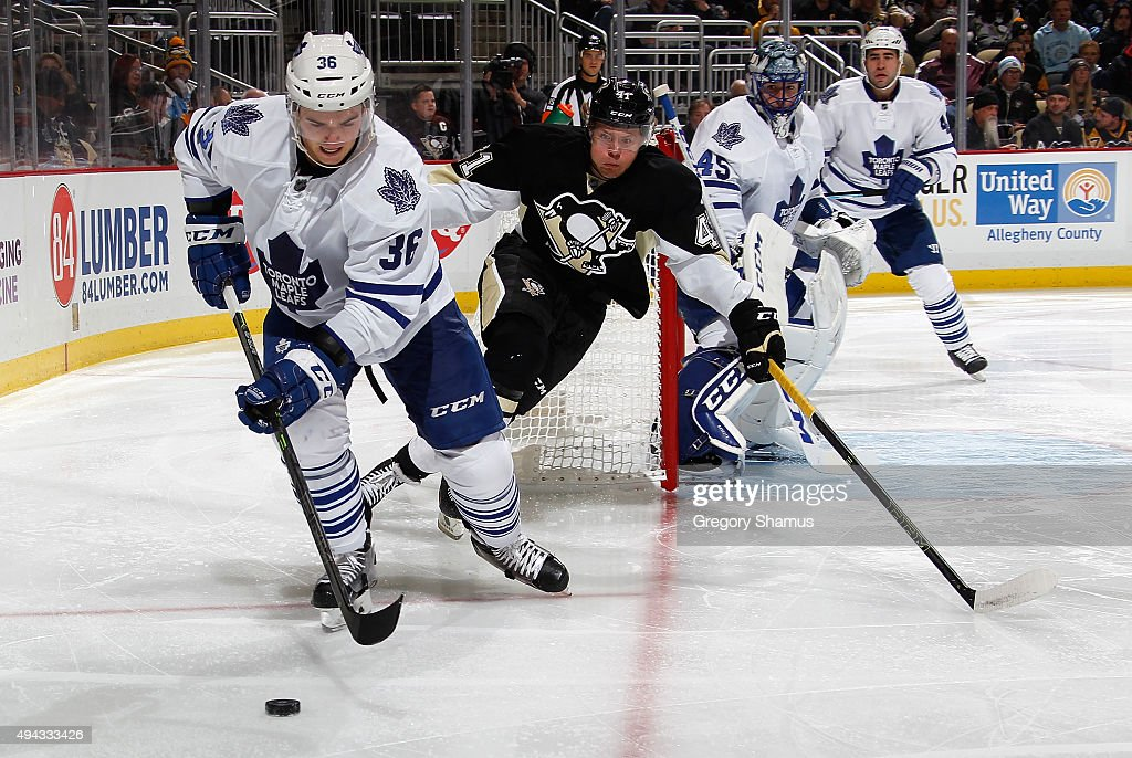 Scott Harrington #36 of the Toronto Maple Leafs moves the puck in front of Daniel Sprong #41 of the Pittsburgh Penguins at Consol Energy Center on October 17, 2015 in Pittsburgh, Pennsylvania.