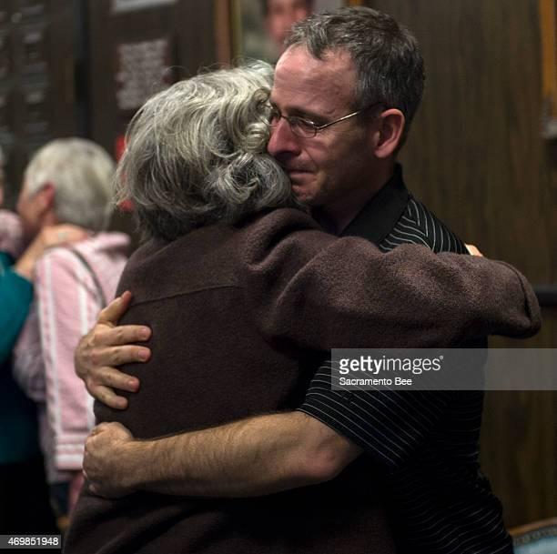 "Scott Harris, right, the son of Robert Edward ""Bob"" Harris, hugs his aunt, Nancy Glaberman, as Colleen Ann Harris is found guilty of murdering his..."