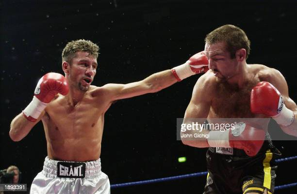 Scott Harrison of Scotland ducks a jab from Wayne McCullough of Northern Ireland during the WBO featherweight title fight between Scott Harrison of...