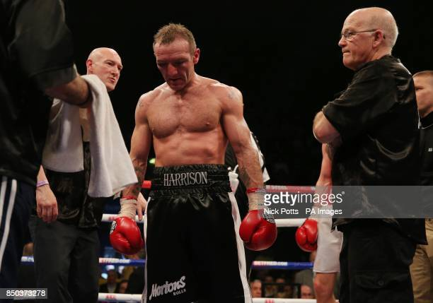 Scott Harrison stands dejected after losing to during the WBO European Lightweight Championship fight at Wembley Arena London