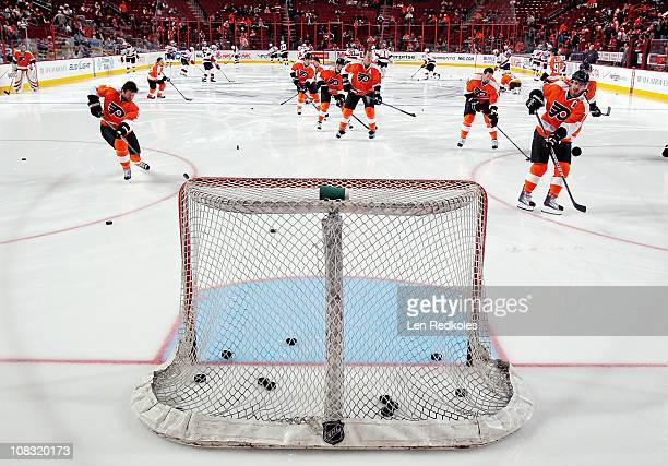 Scott Hartnell Chris Pronger Jody Shelley and Mike Richards of the Philadelphia Flyers all shoot pucks into an empty net during the pregame warm ups...
