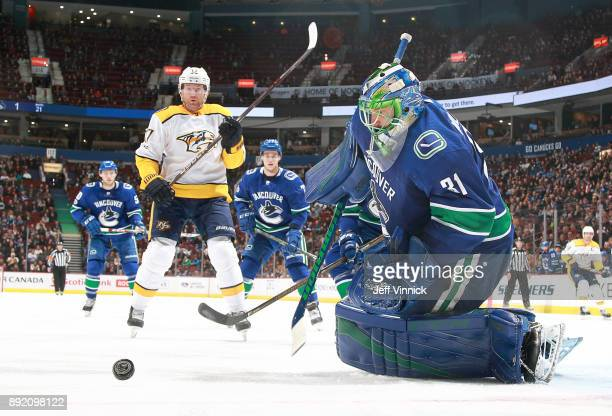 Scott Hartnell of the Nashville Predators looks on as Anders Nilsson of the Vancouver Canucks makes a save during their NHL game at Rogers Arena...