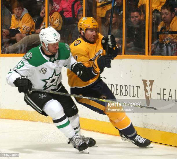 Scott Hartnell of the Nashville Predators skates against Marc Methot of the Dallas Stars during the third period of a 41 Predators victory at...