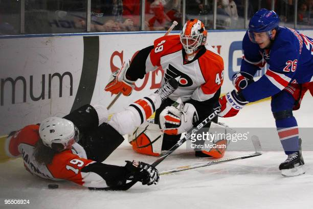 Scott Hartnell of the Philadelphia Flyers and goal keeper Michael Leighton defend against Erik Christensen of the New York Rangers during their game...
