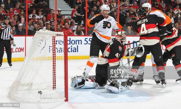 Scott Hartnell of the Philadelphia Flyers celebrates a second period goal against Craig Anderson of the Ottawa Senators as Chris Phillips of the...
