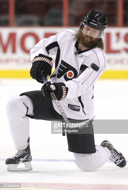 Scott Hartnell of the Philadelphia Flyers flips a puck from a kneeling position during practice for the 2010 NHL Stanley Cup Final at Wachovia Center...
