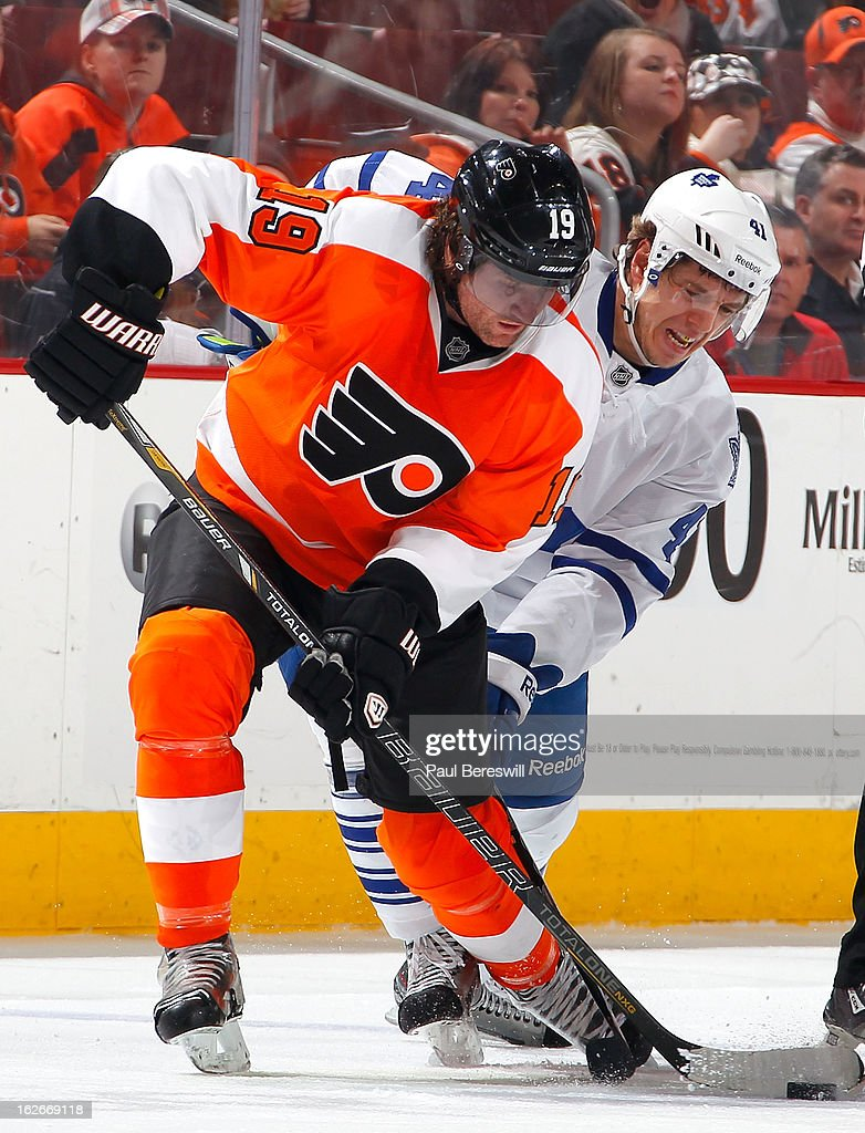Scott Hartnell #19 of the Philadelphia Flyers is checked closely by Nikolai Kulemin #41 of the Toronto Maple Leafs in the second period of an NHL Hockey game at Wells Fargo Center on February 25, 2013 in Philadelphia, Pennsylvania.