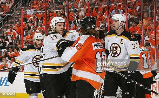 Scott Hartnell of the Philadelphia Flyers is involved in a scrum against Shawn Thornton Milan Lucic and Zdeno Chara of the Boston Bruins in Game...